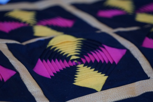 Tiny hand stitched silk pieced quilts from the sik road